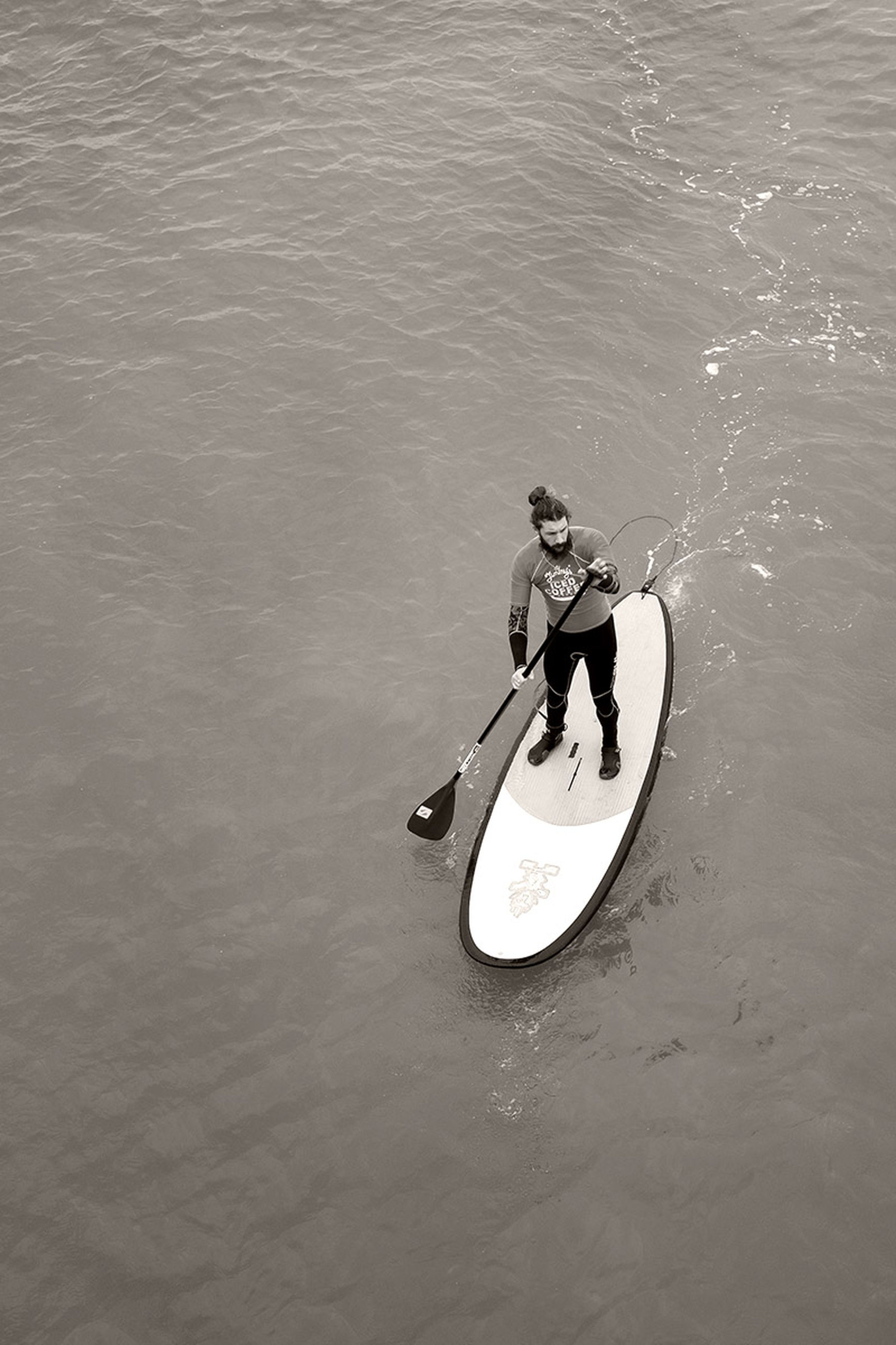 water, leisure activity, high angle view, lifestyles, men, waterfront, full length, skill, motion, sport, sea, reflection, day, transportation, hobbies, vacations, outdoors