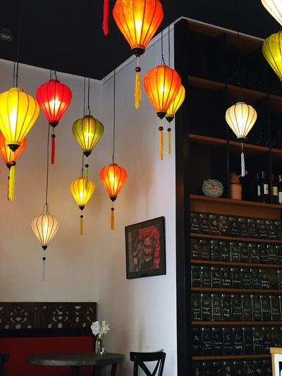 Low angle view of illuminated lanterns hanging
