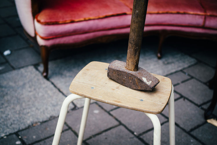 High angle view of hammer on stool at street