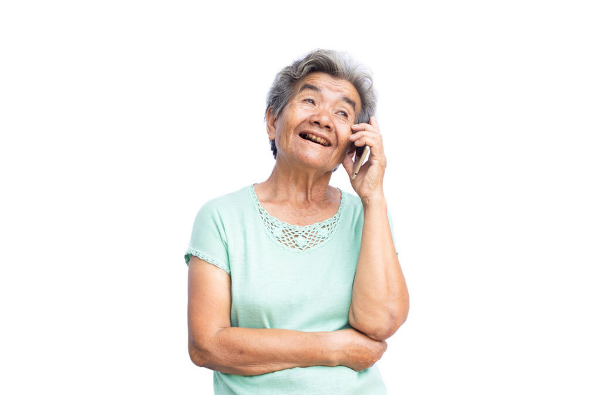 Happy Missing Connection One Person Senior Adult Smart Phone Smiling Standing Talking Technology Using Phone White Background Women