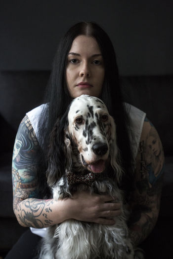 Adult Adults Only Animal Themes Dog Dogs Domestic Animals Human Body Part Indoors  Long Hair Looking At Camera One Animal One Person People Pets Portrait Tatoo