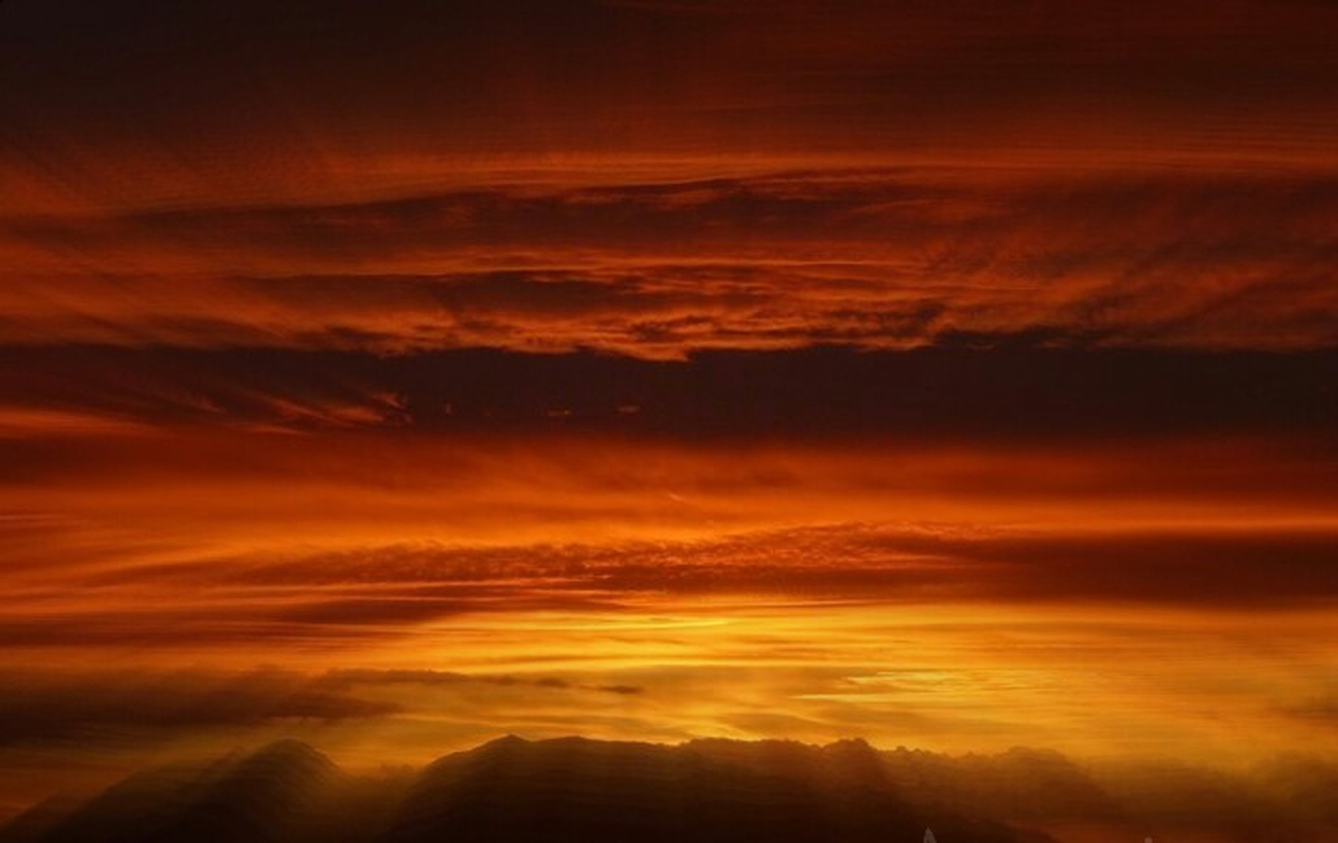 sunset, scenics, beauty in nature, sky, tranquil scene, orange color, tranquility, cloud - sky, idyllic, nature, dramatic sky, cloudscape, majestic, cloud, landscape, cloudy, weather, awe, atmospheric mood, outdoors