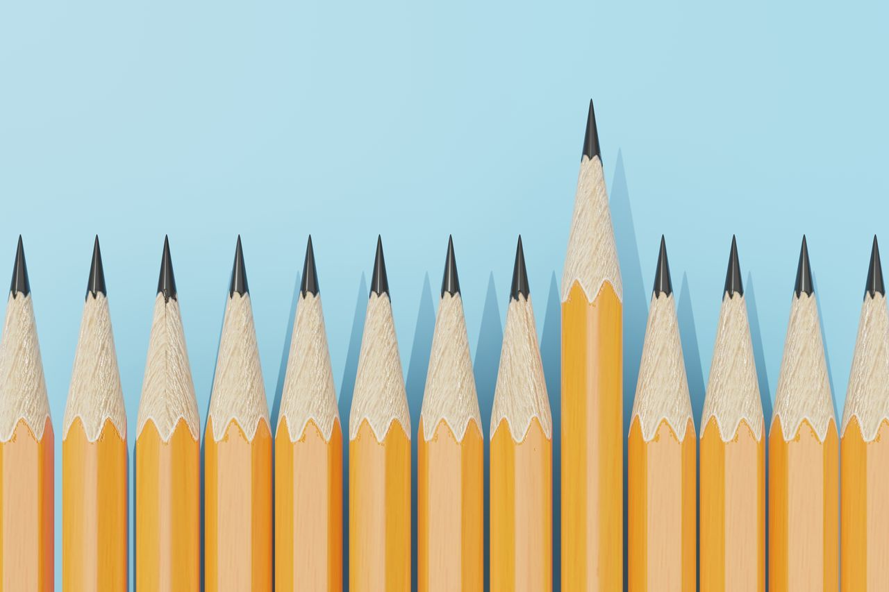 CLOSE-UP OF YELLOW PENCILS AGAINST SKY