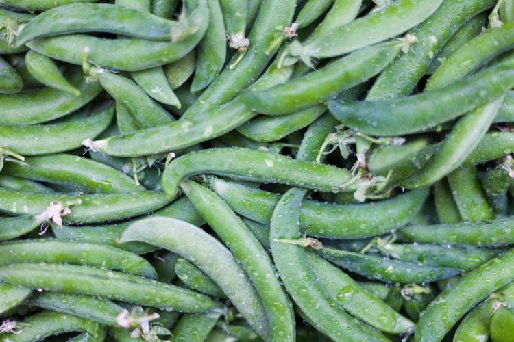 Full frame shot of wet green peas at market