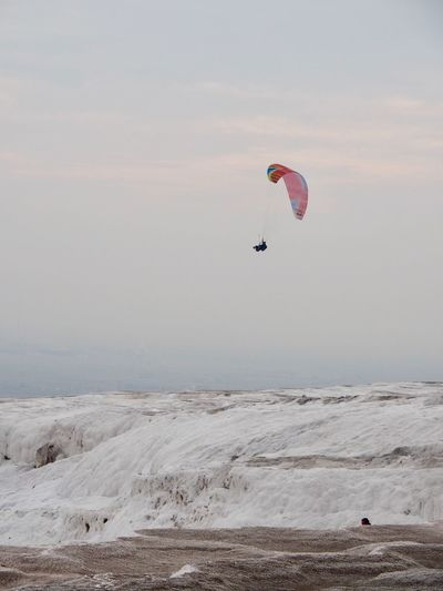Extreme Sports Adventure Land Sport Mid-air Scenics - Nature Flying Sky Paragliding Leisure Activity Nature Beauty In Nature Unrecognizable Person Environment Parachute Outdoors Joy