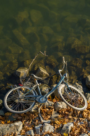 High angle view of bicycle parked on rock