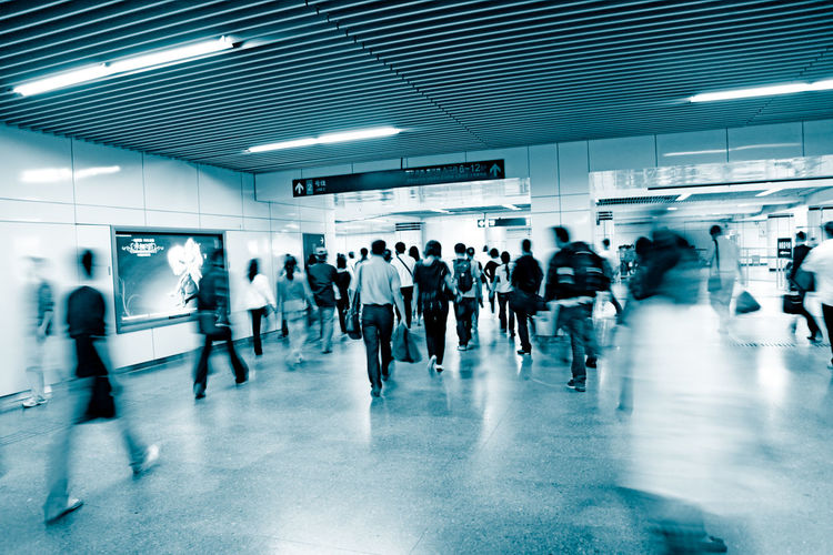 Group of people walking in subway station