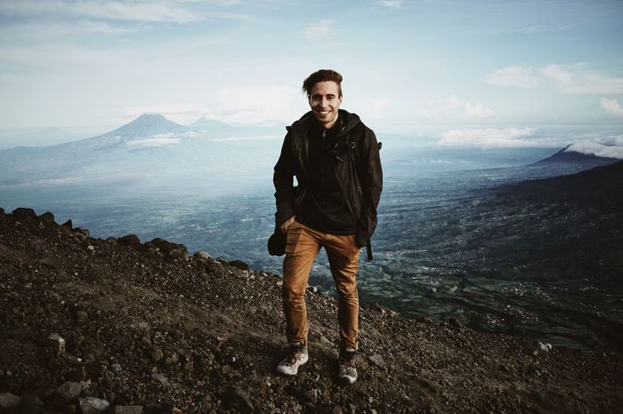Climbing Gunung Merapi volcano Black Jacket Blue Sky Brown Trouser Climbing Day Front View Hiking INDONESIA Leisure Activity Lifestyles Looking At Camera Merapi Mountain Nature One Person Outdoors People Rocky Ground Scenics Smiling Standing Traveling Trekking Volcano Young Adult Lost In The Landscape