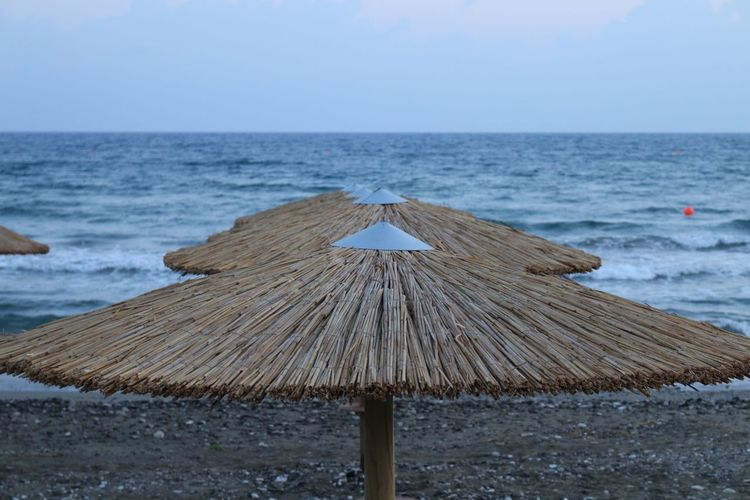 Cyprus Limassol Wave Beachphotography Seaside Sea Sea Water Horizon Over Water Beach Horizon Sky Beauty In Nature Thatched Roof Land Scenics - Nature Tranquility Roof Umbrella Parasol Tranquil Scene Nature No People Day Protection Outdoors