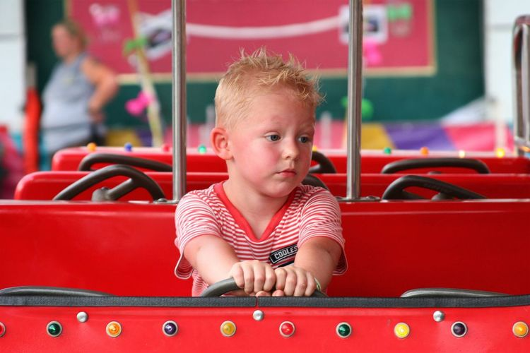 Childhood Real People Blond Hair Red One Person Boys Leisure Activity Carnival Carnival Rides Playing Day Portrait Close-up People Boy EyeEmNewHere Neon Life EyeEm Selects Kid The Week On EyeEm