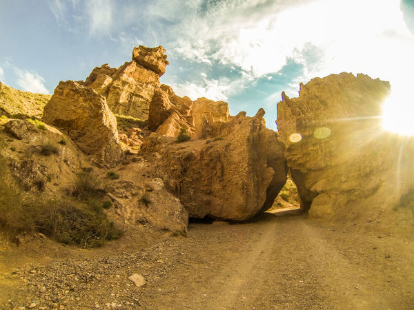 A road threw a canyon Canyon Canyon Road Day No People Outdoors Rock - Object Rock Formation Rocks Sky Stones Sunlight
