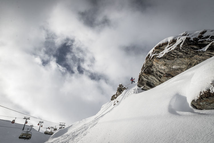 Snow Winter Cold Temperature Cloud - Sky Sky Mountain Sport Scenics - Nature Beauty In Nature Adventure Day Nature Leisure Activity Activity Extreme Sports Winter Sport White Color Real People Mountain Range Outdoors Snowcapped Mountain