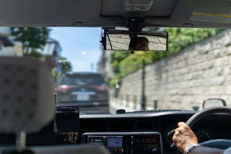 Japanese taxi. Driving Japan Rear View Taxi Taxi Driver Travel Traveling Car Car Interior City Driving Hand Human Hand Kobe Land Vehicle Mode Of Transportation Motor Vehicle Rear-view Mirror Road Street Taxiway Transparent Transportation Vehicle Interior
