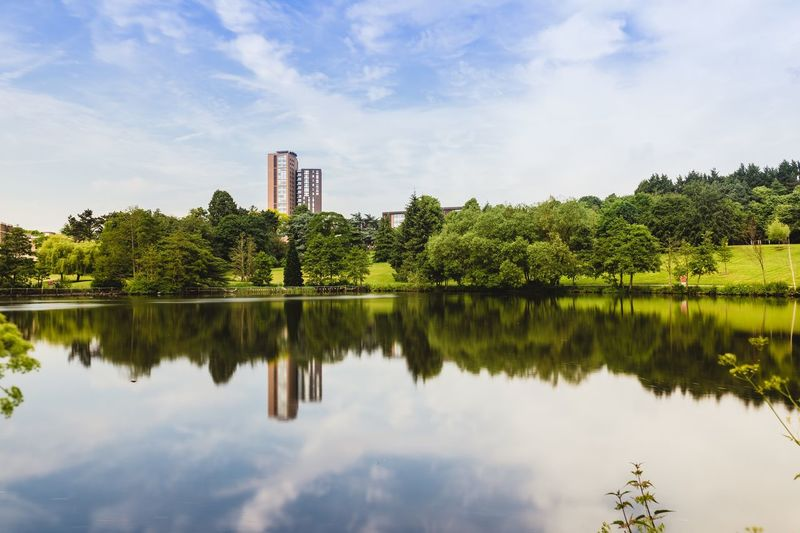 Sky Water Reflection Plant Tree Nature Lake Cloud - Sky Architecture Waterfront Tranquility Green Color Day Beauty In Nature Built Structure Scenics - Nature Outdoors No People Building Building Exterior First Eyeem Photo