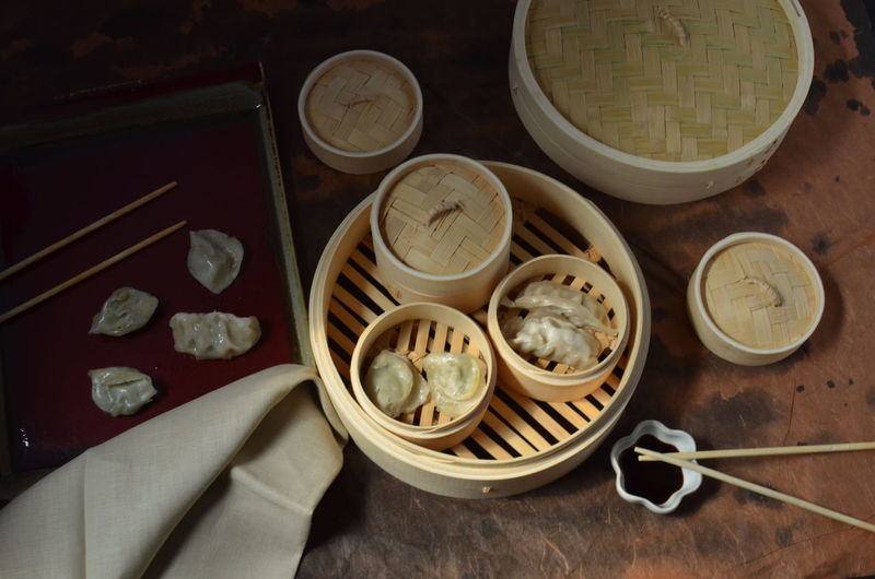 Dim Sum pot stickers in bamboo steamer Bamboo Steamer Breakfast Time Breakfast ♥ Chinese Food Chopsticks Dim Sum Fresh Group Of Objects No People Pot Stickers Ready-to-eat
