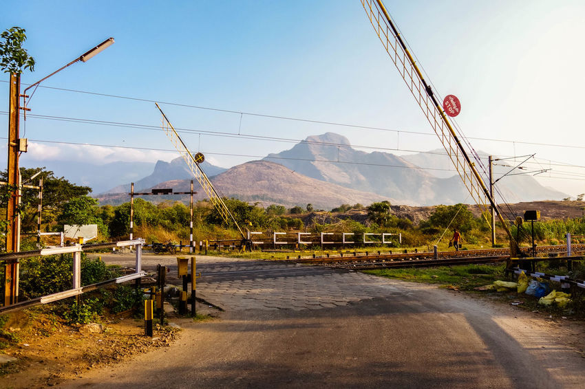 Railway Crossing Beautiful Cable Clear Sky Country Road Crossing Day Electricity  Electricity Pylon Here Belongs To Me India Kerala Mountain Mountain Range Mountains Nature Palakkad Pole Power Line  Railway April Showcase Road Sign Sky Village Western Ghats The Great Outdoors - 2016 EyeEm Awards