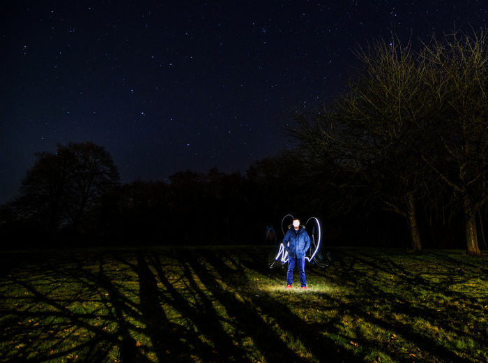 Adventure Astronomy Beauty In Nature Clear Sky Constellation Field Freedom Full Length Grace Landscape Long Exposure Nature Night Outdoors People Scenics Sky Space Spotlight Star - Space Star Field Young Adult