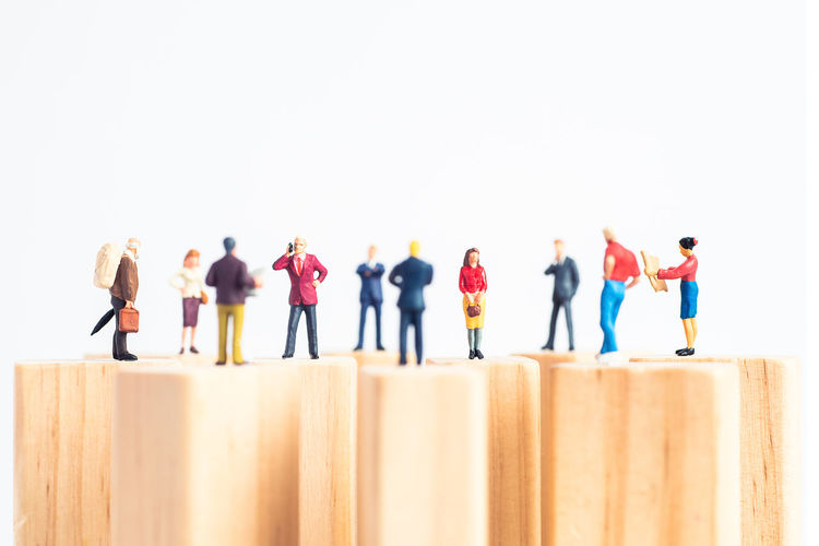 Rear view of people standing against white background