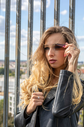 Beautiful Woman Blond Hair Casual Clothing Clothing Day Fashion Front View Hair Hairstyle Jacket Leather Leather Jacket Leisure Activity Lifestyles Long Hair One Person Outdoors Portrait Real People Standing Teenager Waist Up Warm Clothing Young Adult Young Women EyeEmNewHere