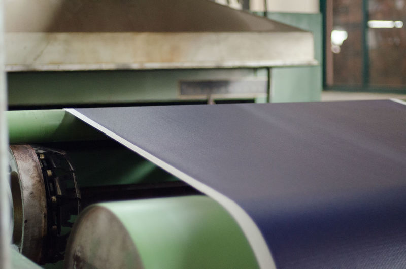 Close-up of exercise mat on conveyor belt in factory