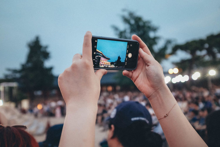 People photographing through smart phone