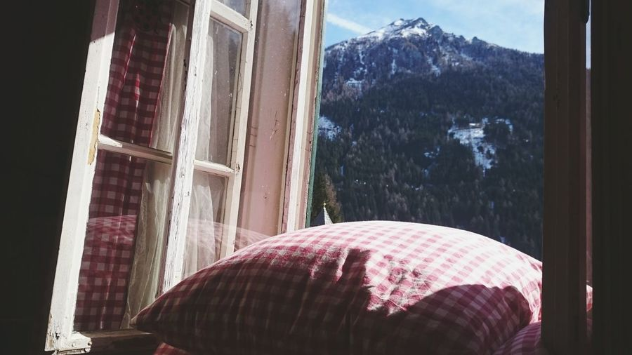 Good Morning Mallnitz Auernig Austrianphotographers From My Window Perfect Weather Mountain View Red White Pillows And Blankets Austria Sunshine Morning View Old Windows Snow On Mountains Spring2016 Spring Has Arrived