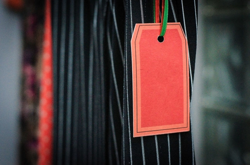 Close-up of red label hanging on clothes
