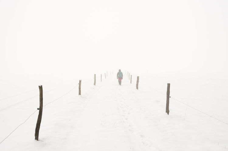 Winterwanderland Fog Foggy Center Copy Space EyeEm Nature Lover EyeEmNewHere Hiking Leading Lines Nature Path Walk Cold Cold Temperature Day High Key Hikingadventures Landscape Nature One Person Outdoors People Snow The Way Forward Warm Clothing White Winter