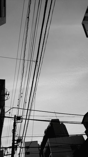 Cable Sky Business Finance And Industry Electricity Pylon Electricity  Built Structure Power Supply Silhouette No People Day Architecture Sunset Outdoors Golf Club Technology Black And White Collection  Black And White Collection  Blackandwhite Blackandwhiteonly Blackandwhite Photography Monochrome World Blackandwhitepics Architecture Skyscraper Street