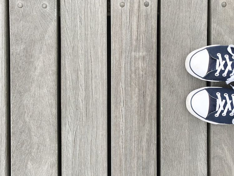 Wood - Material Pattern Communication Day Textured  Close-up No People Outdoors Shoes Blue White Look Down Full Frame Planks Surface Background Grey Gray Wood Slats Boardwalk