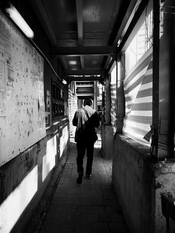 Full Length Rear View Real People Walking Lifestyles Men Indoors  Leisure Activity One Person Built Structure Day People Adult HongKong Black And White Blackandwhite Photography Black And White Photography IPhone IPhoneography Blackandwhite Architecture_bw Stories From The City Stories From The City