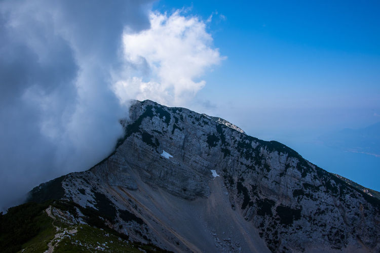 Clouds over the peaks of the alps on lake garda in the province of verona, italy