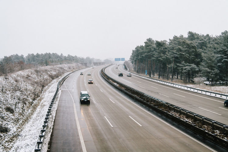 Winterly Motorway Autobahn Car Cars Cold Infrastructure Journey Land Vehicle Melancholy Mode Of Transport Motorway Nature On The Move Remote Road Road Marking Scandinavian Scenery Snow Speed Street Traffic Transportation Travel Vehicle Winter