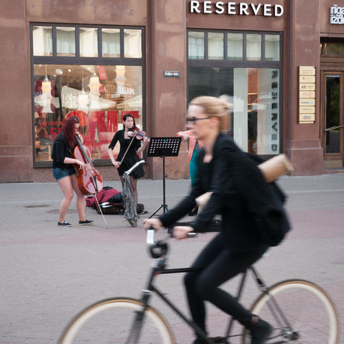 Adult Bicycle City City Life Cycling Day Motion Musician Outdoors People Riga Streetphotography Sustainable Lifestyle Sustainable Resources Transportation Women Young Adult Young Women