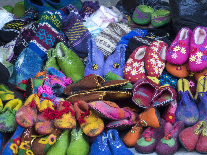Selling shoes of felt at the fair. Handmade. Celebration Close-up Day Fair Felt For Sale Handmade Large Group Of Objects Multi Colored No People Outdoors Selling Shoes Shoes Of Felt Variation