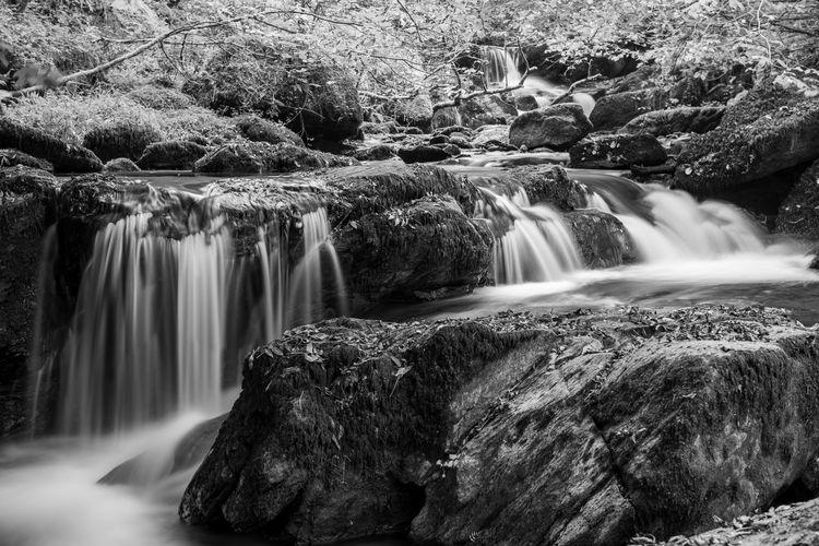 Long exposure of a waterfall on the hoar oak water river at watersmeet in exmoor