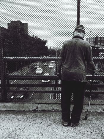 The traffic watcher. EyeEm Bnw People Watching Street Photography Bnw_friday_eyeemchallenge