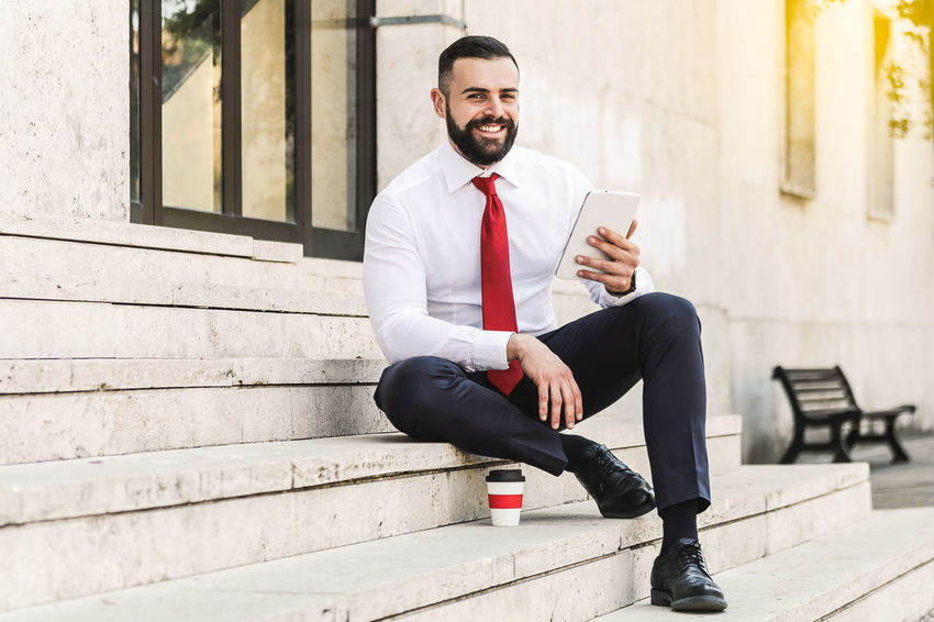 Model: Roberto Materiale Architecture Built Structure Communication Connection Day Front View Full Length Leisure Activity Lifestyles Males  One Person Outdoors Portrait Real People Sitting Technology Wireless Technology Young Adult Young Men