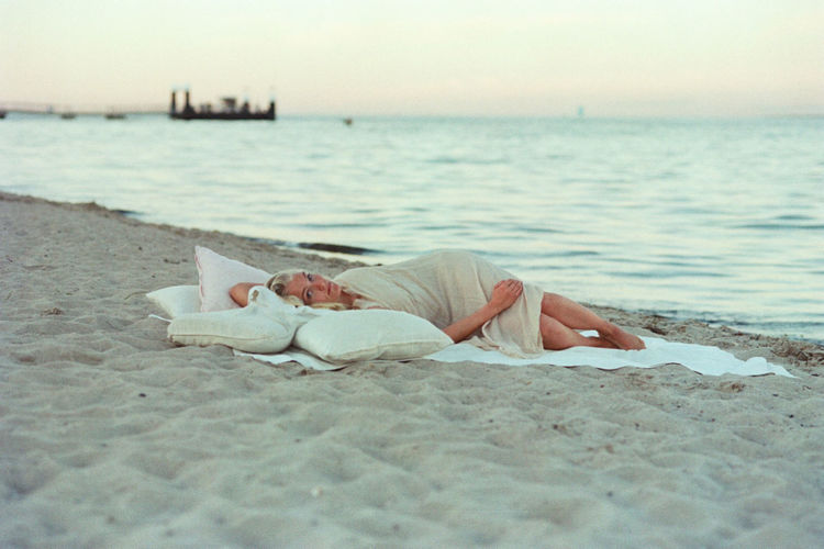 Adult Beach Beauty In Nature Close-up Day Full Length Horizontal Lying Down Nature One Person One Woman Only Only Women Outdoors People Person Pillow Real People Relaxation Sand Sea