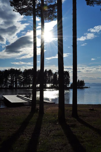 Beauty In Nature Light And Shadow Non-urban Scene Reflection Remote Sky Sunbeam Sunlight Sunny Symmetry Tranquil Scene Tranquility Tree Water Bythelake Lake View EyeEm Best Shots Original Experiences Enjoying The View EyeEm Nature Lover Miles Away Sweden