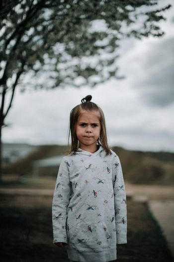 Her thinking face Looking At Camera Portrait One Girl Only One Person Focus On Foreground Girls Childhood Child Front View Children Only Standing Outdoors Nature Day Smiling Sky People