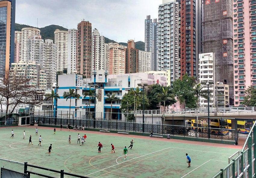 Architecture Causeway Bay City Cityscape Football Football Pitch Game Hong Kong Island Leisure Activity Playing Skyscraper Sport Young Men People Together Battle Of The Cities Adapted To The City The Street Photographer - 2017 EyeEm Awards