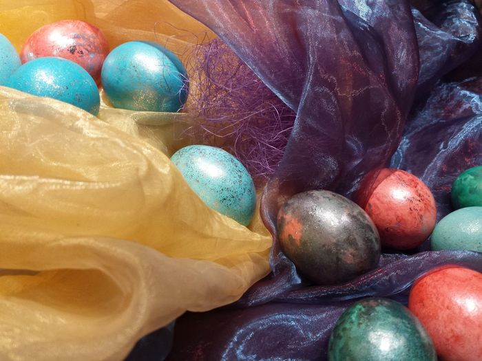 High angle view of easter eggs on fabric