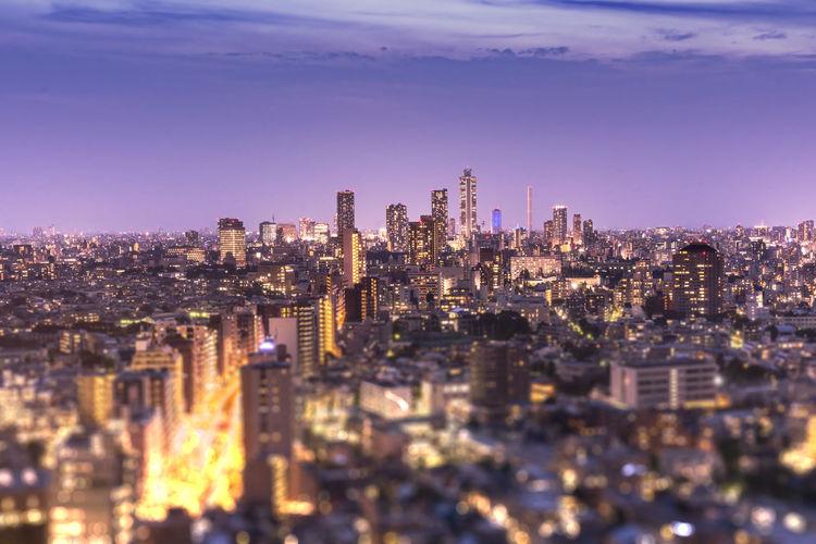 Aerial view of ikebukuro skyscrapers illuminated in the night of tokyo.