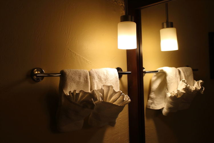 Indoors  No People Illuminated Lighting Equipment Wall - Building Feature Domestic Room Light Hygiene Close-up Clothing Electric Light Paper Textile Wood - Material Hanging White Color Still Life Absence Home Interior Bed Electric Lamp