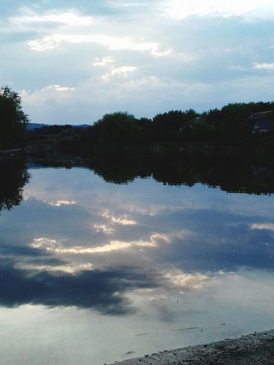 Scenic view of reflection of clouds in water