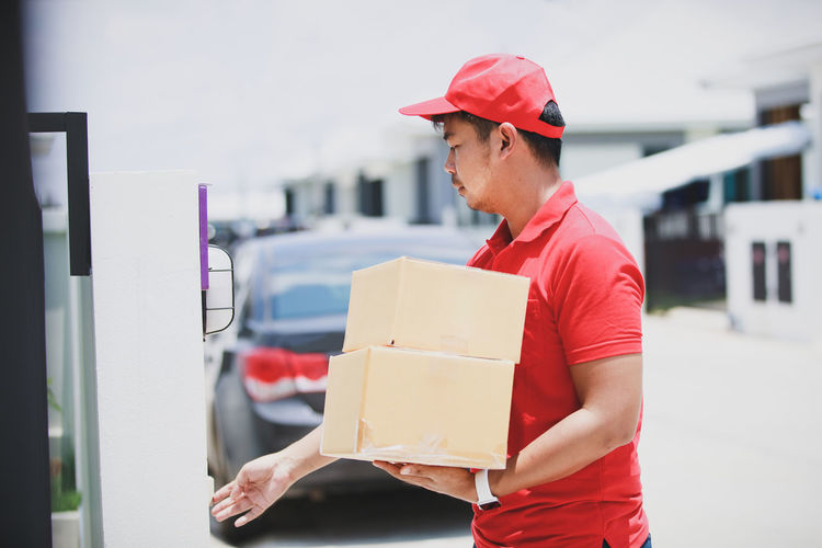 Side view of man working in box