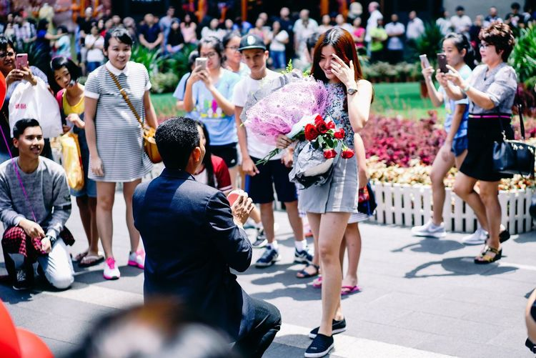 In surprise with joy.. Large Group Of People Arts Culture And Entertainment Audience Performance Crowd Day Outdoors Real People Men People Spectator Women Marriage  Proposal Proposal Of Marriage In Public