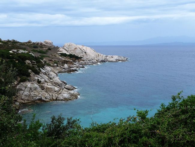 Wonderful coast of Sardinia Sardinia Coastline Santa Teresa Di Gallura Italy Turquoise Water Sea Sky Horizon Over Water Rocks Rocks And Water Tranquil Scene Landscape Nature Outdoors Marine Seashore Vacations Non-urban Scene Rain Clouds