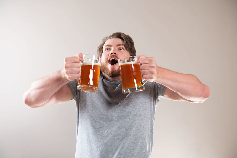 Portrait of man drinking beer glass